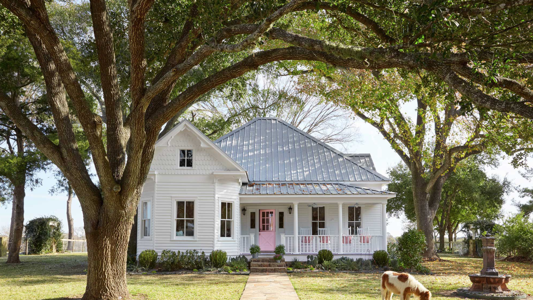 Victorian Folk Farmhouse Exterior with white siding and pink door